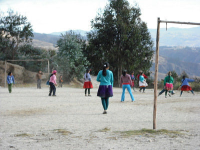 Quechua girls playing football