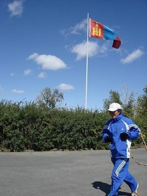 Baigal passes by Mongolian Flag
