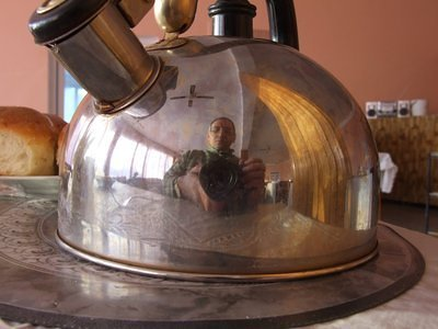 Reflection of the photographer himself in the kettle