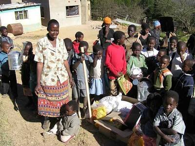 Thandazile, the volunteer teacher with the children