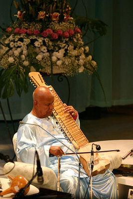 Sri Chinmoy playing the esraj