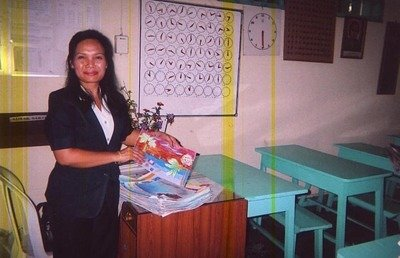 Teacher with Drawings of Hope from Saraswati School in Bali