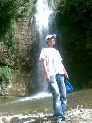 me at waterfall in botanical garden