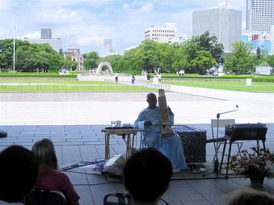 Sri Chinmoy performs a public concert beneath the shadow of the Hiroshima Peace Memorial Museum