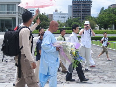 Sri Chinmoy walks towards the Memorial Park Cenotaph.