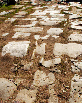 Perge - ruts from pathway of chariots on the road remains in the center of town.