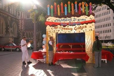The cake was set up in Cathedral Square, beside the Cathedal Sri Chinmoy performed in at Christmas time 2002.