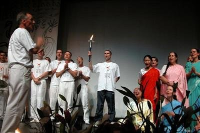 singing the  World Harmony Song with the torch.