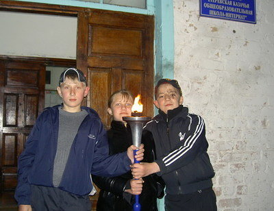 World Harmony Run torch at a boarding school