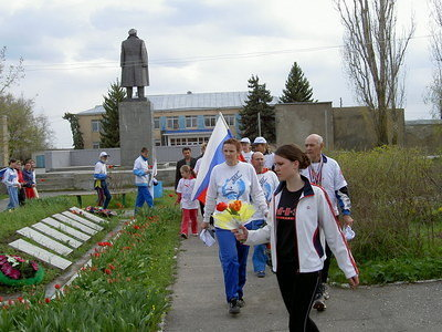 Placing the flowers to memorial in Danilovka